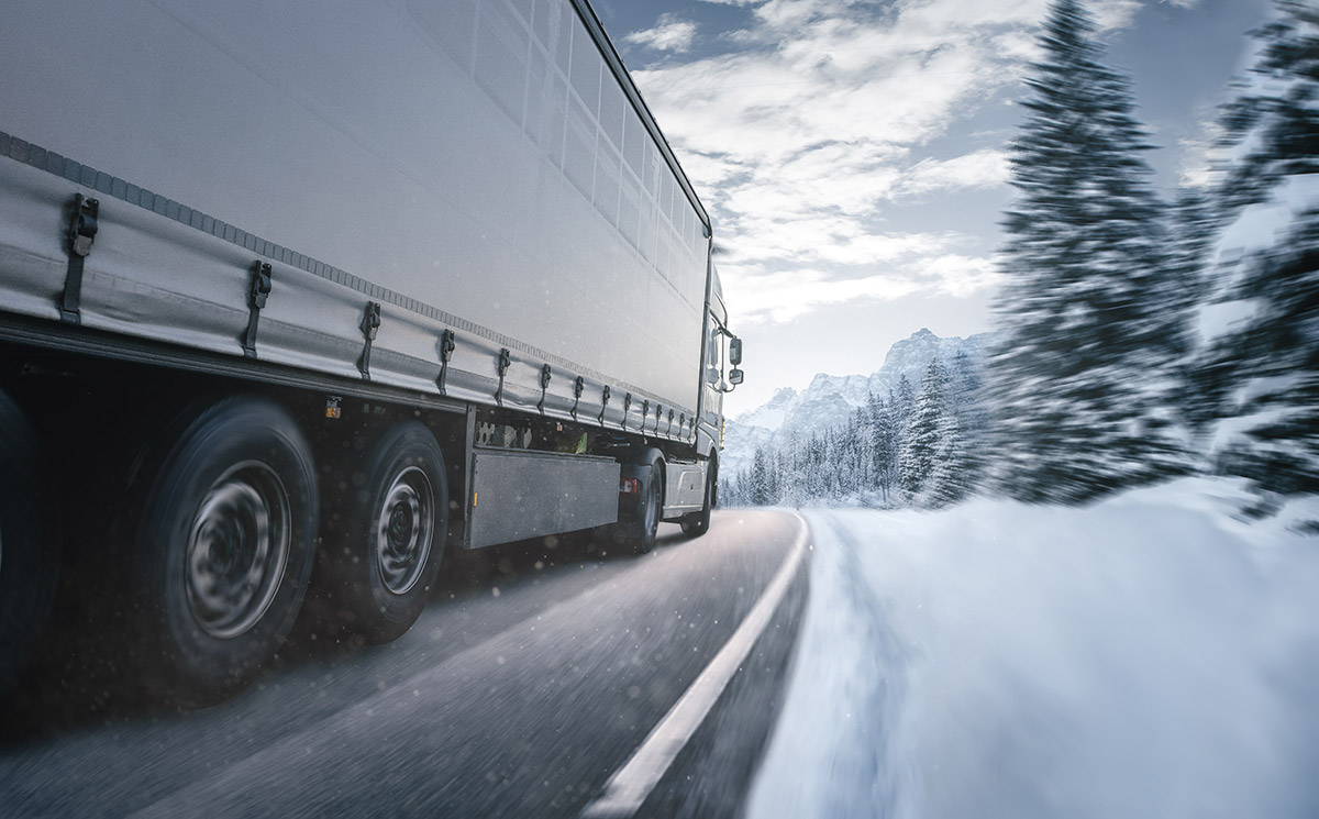 Freeze-thaw stability in harsh conditions. Truck driving in snow landscape with cellulose fibrils.
